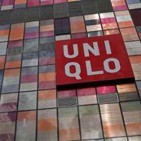 A company logo is seen on the exterior of a UNIQLO store at Taikoo Li Sanlitun shopping centre in Beijing