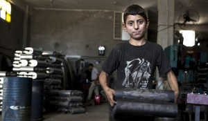 Young Syrian refugee in Egypt. Photo by AFP